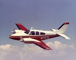 A 1962 Baron C55 in the factory paint scheme[a]