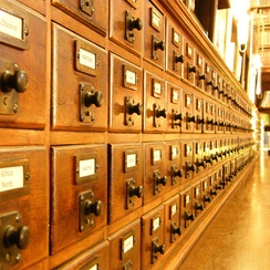 Until the advent of digital catalogues, card catalogues were the traditional method of organizing the list of resources and their location within a large library.