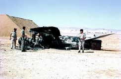 Israeli troops examine destroyed Egyptian aircraft.