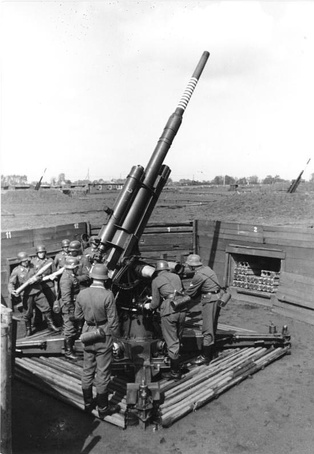 German 88 mm flak gun in action against Allied bombers.