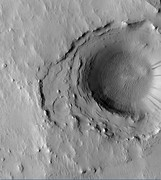 Crater in the middle of Cassini, as seen by HiRISE.  Layers may have been deposited under water since it is believed that Cassini once held a giant lake.