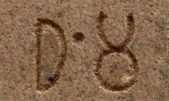 "The Prakrit word ""Dha-m-ma"" (equivalent to the Sanskrit word Dharma) in the Brahmi script, as inscribed by Ashoka in his Edicts of Ashoka, 3rd century BCE."