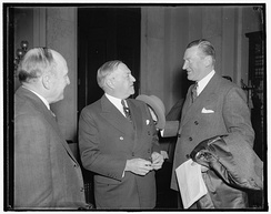 Federal Housing Administrator Stewart McDonald (right) discusses with Senator Robert F. Wagner, author of The Wagner Housing Act
