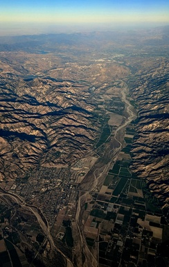 Late afternoon aerial view of Fillmore (left foreground) and the Santa Clara River Valley.  State route 126 runs along the valley, to Castaic Junction at the east end.