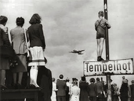 Germans watching Western supply planes at Berlin Tempelhof Airport during the Berlin Airlift.
