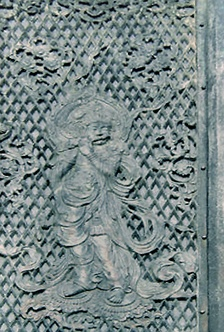 Depiction of Hindu deity Krishna playing the flute in a temple constructed in 752 CE on the order of Emperor Shomu, Todai-ji Temple, Great Buddha Hall in Nara, Japan