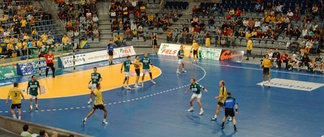 The referees (blue shirts) keep both teams between them.