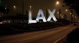 Sign at the Century Blvd. entrance to Los Angeles International Airport greets visitors