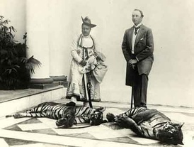 Curzon and Madho Rao Scindia, Maharaja of Gwalior, pose with hunted tigers, 1901.