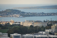 The museum seen from Maungawhau / Mount Eden, showing the wavy shape of the copper dome.