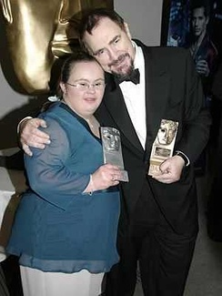 Cox with Paula Sage receiving her BAFTA award