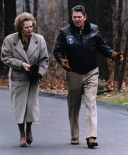 Ronald Reagan and Margaret Thatcher walk at Camp David in 1986.