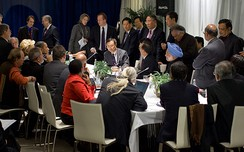 India's Prime Minister Manmohan Singh (blue) and Indian Minister of Environment and Forests Jairam Ramesh (behind) during a multilateral meeting with U.S. President Barack Obama, Chinese Premier Wen Jiabao, Brazilian President Lula da Silva and South African President Jacob Zuma at the United Nations Climate Change Conference.