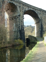 Saddleworth Viaduct was built originally to aid the transporting of goods during the Industrial Revolution, as was the Huddersfield Narrow Canal, which passes under it.