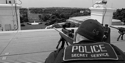 A US Secret Service sniper on the roof of the White House