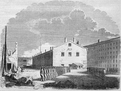 "An 1855 engraving of New York's Sing Sing Penitentiary, which also followed the ""Auburn (or Congregate) System"", where prison cells were placed inside of rectangular buildings that lent themselves more to large-scale penal labor."