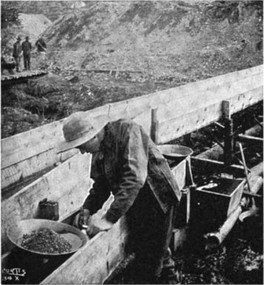 Taking gold out of a sluice box, western North America, 1900s