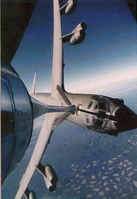 A USAF B-52 being refueled by a KC-135 at a high bank angle.