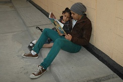 Volunteer reads to a girl at the Casa Hogar de las Niñas in Mexico City