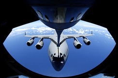 A C-17 Globemaster refuels through the boom of a Boeing KC-135 Stratotanker.