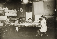Early 20th century witnessed many home-based enterprises involving child labour. An example is shown above from New York in 1912.