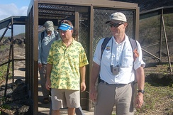 USFWS Director Dan Ashe entering Kaena Point State Park through a gate in the predator proof fence