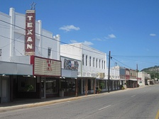 A glimpse of downtown Junction, with the defunct Texan Theater at the left