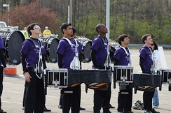 A marching drum line warming up, 2011