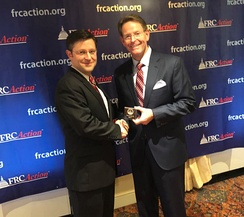 Johnson receiving the True Blue award from FRC President Tony Perkins in 2018