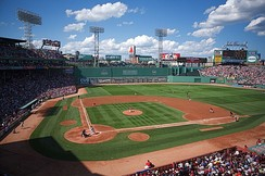 Fenway Park, home of the Boston Red Sox. The Green Monster is visible beyond the playing field on the left.