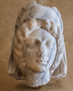 A sculpted marble head of an elite woman with a hairstyle commonly associated with Julia Domna, wife of the Roman Emperor Septimius Severus. This late 2nd/ early 3rd century head, made from marble from Turkey, was found in the 2016 excavations of the Eastern Roman Baths at Jerash, Jordan and is displayed in the Jerash Visitor Center.
