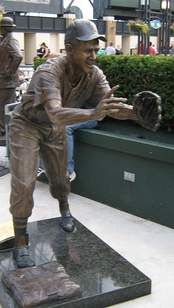 In bronze, shortstop Aparicio waits for the baseball being flipped from teammate Nellie Fox.