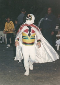 Mascarita Sagrada wearing a mask that covers his entire face.
