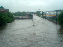 A road near Meadowhall Centre showing extensive flooding after the River Don burst its banks