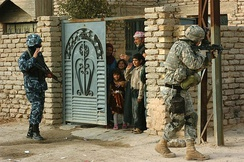 A paratrooper from 505th Infantry conducts joint patrol with an Iraqi policeman in Samarra, Iraq