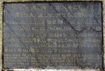 "A memorial plaque for a member of the Voluntary Aid Detachment, engraved with a quotation from the Epilogue to Browning's Asolando. The inscription reads: ""In Loving Memory of Louisa A. M. McGrigor Commandant V.A.D. Cornwall 22. Who died on service, March 31, 1917. Erected by her fellow workers in the British Red Cross Society, Women Unionist Association, Boy Scouts, Girl Guides and Friends. One who never turned her back but marched breast forward, Never doubted clouds would break, Never dreamed, though right were worsted, wrong would triumph, Held we fall to rise, are baffled to fight better, Sleep to wake."""
