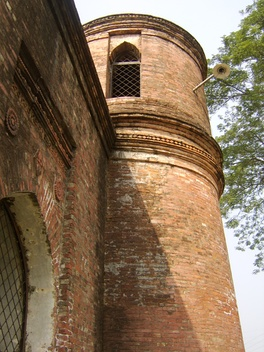 Minaret of the 15th-century Sixty Dome Mosque, listed by UNESCO as a World Heritage Site