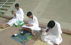 Pilgrims wearing Ihram on the plains of Arafat on the day of Hajj