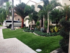 A home's yard with artificial grass.