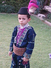 An Assyrian child wearing traditional clothing.