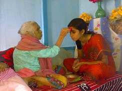 Youngsters greet elders and seek blessings on Dashain (Dashami) among the Hindu community in Nepal and Himalayan regions.