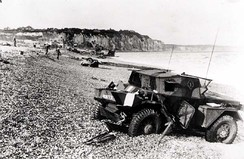 Dieppe's pebble beach and cliff immediately following the raid on 19 August 1942. A scout car has been abandoned