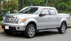 Ford F-150 Supercrew with tonneau, four doors, sidestep, and wind deflectors