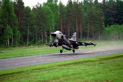 JAS 39 Gripen of the Swedish Air Force taking off from a road runway, as part of a dispersal air base