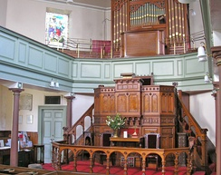 Sanctuary of Heptonstall Methodist chapel. The prominent positioning of the pulpit reflects the emphasis on preaching as the central focus of most services.
