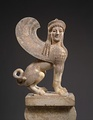 Marble capital and finial in the form of a sphinx, 530 B.C.
