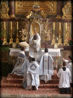A Catholic priest celebrating Tridentine Mass, the form of the Mass prevalent before the Council, showing the chalice after the consecration.