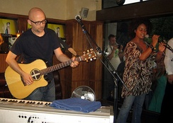 Moby playing guitar with Joy Malcolm in 2008