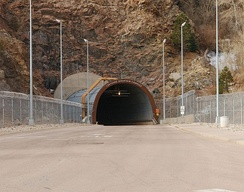 The exterior North Portal protects the eastward tunnel opening. The south opening has a concrete abutment.[16]