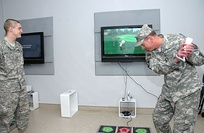 U.S. Army General David H. Petraeus playing an interactive round of Wii golf